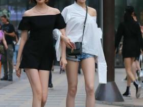 虽然街道风景很美,但是小姐美腿更漂亮